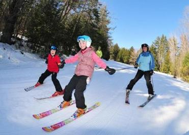 King Pine opened in 1962 with three trails, and remains a place where young skiers and riders first learn to turn..